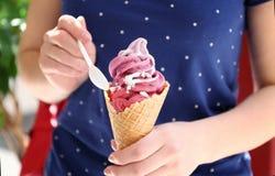 Woman holding portion of yogurt ice cream. Closeup Royalty Free Stock Image