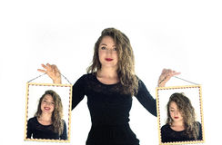 Woman holding portraits with sad and happy faces on white background royalty free stock photos