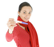 Woman holding a positive pregnancy test Stock Image