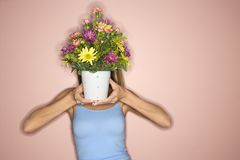 Woman holding pot of flowers. Royalty Free Stock Photos