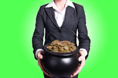 Woman holding pot of gold Stock Photo