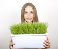 Woman Holding Pot of Green Grass Stock Image