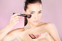 Woman holding powder brush Stock Photo