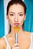 Woman holding powder brush Royalty Free Stock Image
