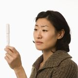 Woman holding pregnancy test. Royalty Free Stock Images