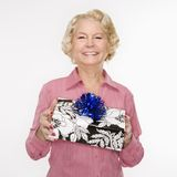 Woman holding present. Royalty Free Stock Photos