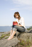 Woman holding a present Royalty Free Stock Photography