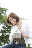 Woman holding a present Royalty Free Stock Photo