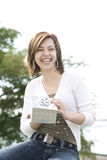 Woman holding a present Royalty Free Stock Photos