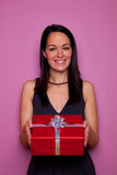 Woman holding a present Royalty Free Stock Images