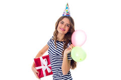 Woman holding present and balloons Royalty Free Stock Image