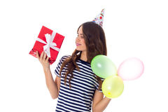 Woman holding present and balloons Stock Image