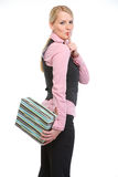Woman holding present box behind back Royalty Free Stock Image