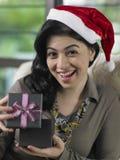 Woman holding present box Royalty Free Stock Photos