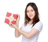 Woman holding with present box Royalty Free Stock Images