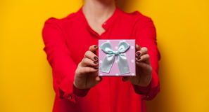 Woman holding a present box Stock Image