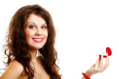 Woman holding a present with engagement ring Royalty Free Stock Image