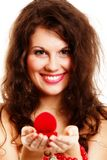 Woman holding a present with engagement ring Stock Images