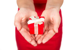 Woman holding present on her hands Royalty Free Stock Photo