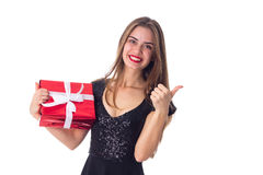 Woman holding a present and showing thumb up Stock Photography