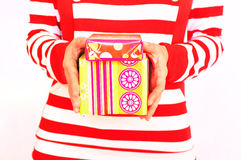 Woman holding presents. Woman dressed in red holding two gift boxes Stock Photos