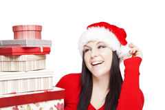 Woman holding presents isolated over white Stock Images