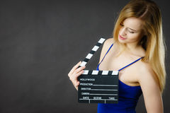 Woman holding professional film slate Stock Images