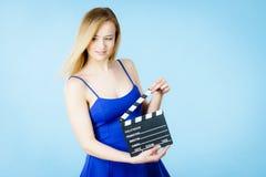 Woman holding professional film slate Royalty Free Stock Photo