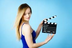 Woman holding professional film slate Stock Photos