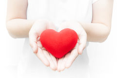 Woman holding and protecting give a red heart shape on white background close-up Royalty Free Stock Photography