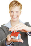Woman holding protecting hand over house Stock Photos