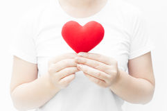 Woman holding and protecting a red heart shape on white background close-up Royalty Free Stock Photography