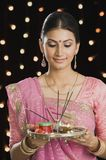 Woman holding a puja thali on Diwali Stock Photo