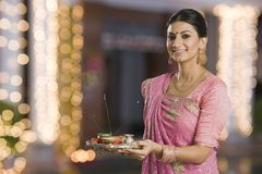 Woman holding a puja thali on Diwali Stock Images