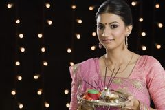 Woman holding a puja thali on Diwali Royalty Free Stock Photography