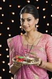 Woman holding a puja thali on Diwali Royalty Free Stock Images