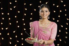 Woman holding a puja thali on Diwali Stock Photography