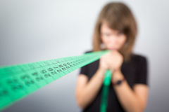 Woman holding pulling measuring meter tape, diet model studio. Royalty Free Stock Photos
