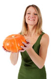 Woman holding a pumpkin Royalty Free Stock Image