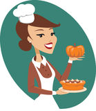 Woman holding pumpkin pie Royalty Free Stock Images