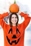 Woman holding a pumpkin Stock Images