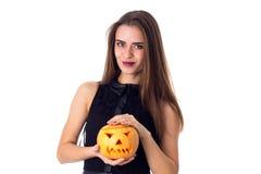 Woman holding a pumpkin Stock Photography