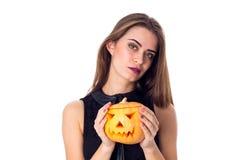 Woman holding a pumpkin Stock Photos