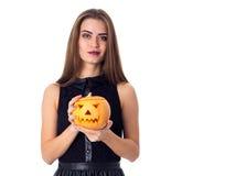 Woman holding a pumpkin Royalty Free Stock Photos