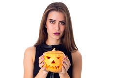 Woman holding a pumpkin Royalty Free Stock Photography