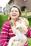 Woman holding puppy Stock Photo