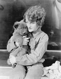 Woman holding puppy Stock Images