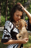 Woman holding puppy royalty free stock photography