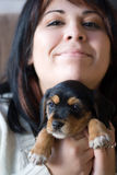 Woman Holding a Puppy Stock Photo