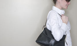 Woman holding purse stock photos